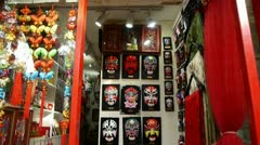 Beijing Opera mask on the store wall,chinese tradition art culture. Stock Footage