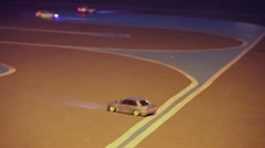 Race of toy cars with radio control on asphalt with marking Stock Footage