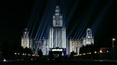 Rays of projectors on Moscow Sate University and street traffic Stock Footage