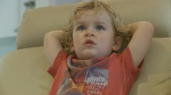Little boy watching TV (mid shot) model release Stock Footage