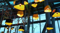 Unusual shape lustre among branches and light equipment Stock Footage