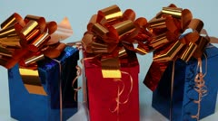 Light flickers on three red and blue gift boxes Stock Footage