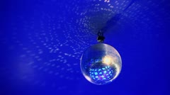 Disco ball hangs under ceiling and circling Stock Footage