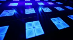 Light curves moves on dance floor with squares Stock Footage