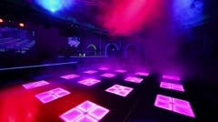 Smoke covers dance floor of night club with illumination - stock footage