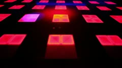 Light spots and laser beams moves on dance floor with squares Stock Footage