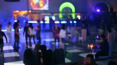 People dance at party in night club with color light, unfocused Stock Footage