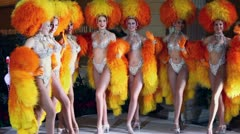 Women in orange fake fur of famous Parisian cabaret Moulin Rouge Stock Footage