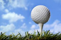 golf ball in grass, close up - stock photo