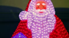 Snowman Santa Claus with many lamps, closeup view in motion - stock footage