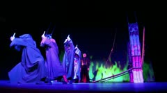 E.Aksenov and actors in medieval monk costumes play in musical - stock footage