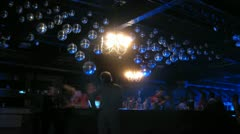 People enjoying mirror ball at concert in Arma Hall Stock Footage