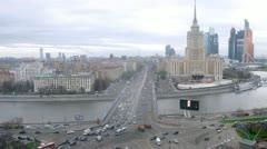 Traffic on Novoarbatsky bridge with Ukraine hotel Stock Footage