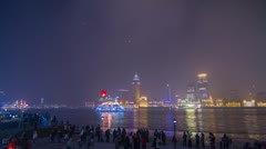 Crowds and Boats Traffic by The Bund with flying lantern Stock Footage
