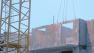 Stock Video Footage of Workers securing block panel on building. Timelapse