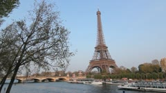 Eiffel Tower and Tourboat on the Seine. Stock Footage