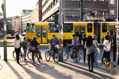 Pedestrians waiting for green light at alexanderplatz Stock Photos