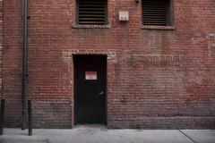 Alley entrance backside of brick building Stock Photos