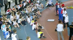 Children at the start line for sprint competition Stock Footage