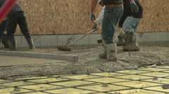 Crew smooths newly poured concrete Stock Footage