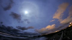 Moon above the breakwall Stock Footage