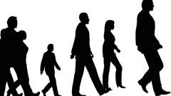 Silhouette of people walking, loopable. - stock footage