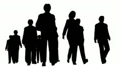 Silhouette of several people walking forward Stock Footage