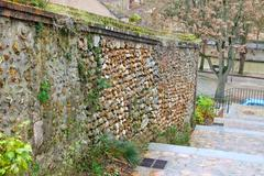 Old stone wall and staircase at chartres. france Stock Photos