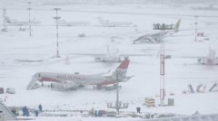 Workers cleaning snow on airfield parking space Stock Footage