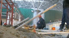 Workers near sand pile at Vnukovo airport terminal Stock Footage