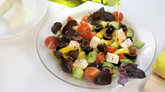 Pouring olive oil on Greek salad, HD - stock footage