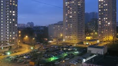 Evening city: parking lot with cars parked, zoom. Timelapse Stock Footage