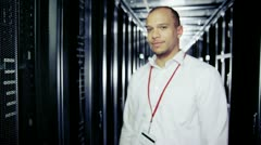 Portrait of a smiling IT engineer working in a data centre - stock footage