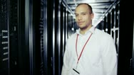 Stock Video Footage of Portrait of a smiling IT engineer working in a data centre