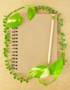 recycle notebook and wooden pencil - stock photo