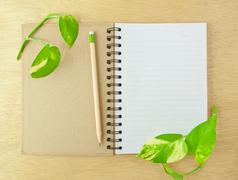 Recycle notebook and wooden pencil Stock Photos