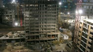 Stock Video Footage of Workers building block during the night. Timelapse