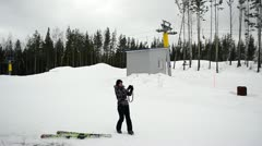 Skier photographs at mountain top Stock Footage