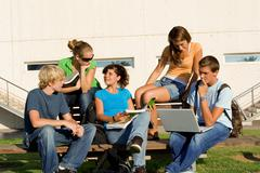 outdoor study group of students - stock photo