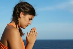 Child praying outdoors Stock Photos