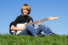 child guitarist, young musician playing guitar - stock photo