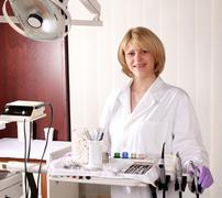 Female dentist with medical equipment Stock Photos