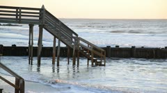 Waves groin pier and dock Stock Footage