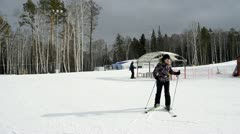 Skier at the bottom of the mountain, near the ski lift Stock Footage