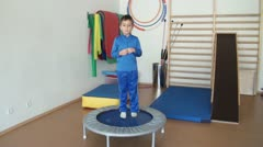 Stock Video Footage of Child is therapeutic exercises in the gym