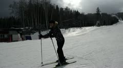 Young woman skiing Stock Footage