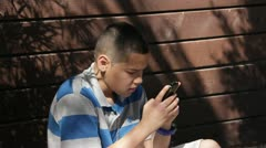 Hispanic boy texting MED room for Text Stock Footage