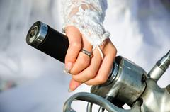 hand of the bride on a motorcycle gas handle - stock photo