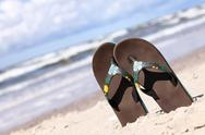Stock Photo of Pair of brown flip-flops