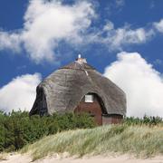 Summerhouse on the beach - stock photo